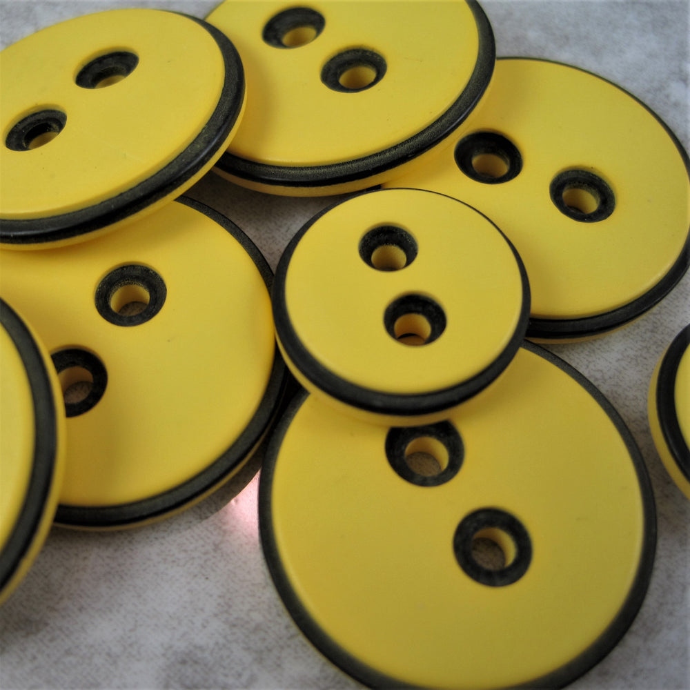 Yellow button with black edging