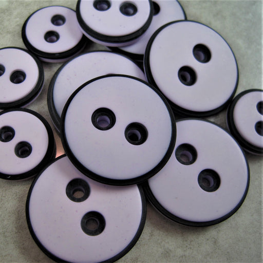 Pale Lilac button with black edging