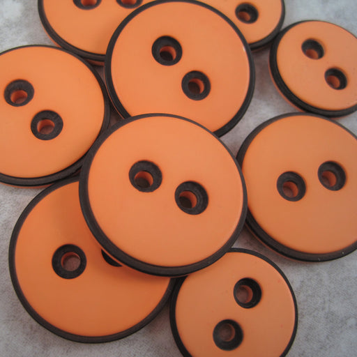 Pale Orange button with black edging