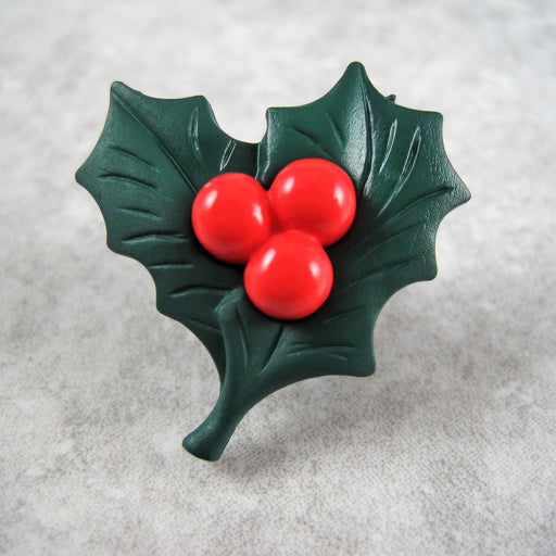 Christmas holly button with red berries.