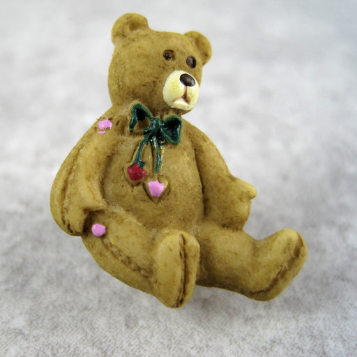 Tan bear with neck bow..