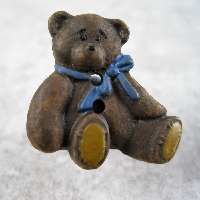 Brown bear with blue bow.