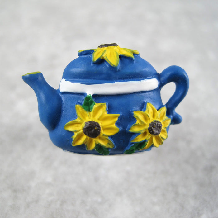 Blue teapot button