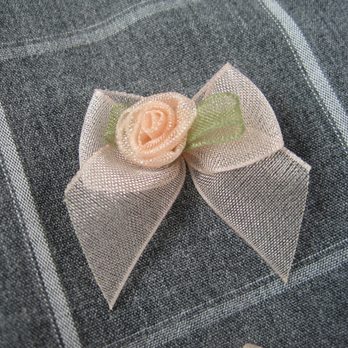 Sheer bow with Peach rose bud