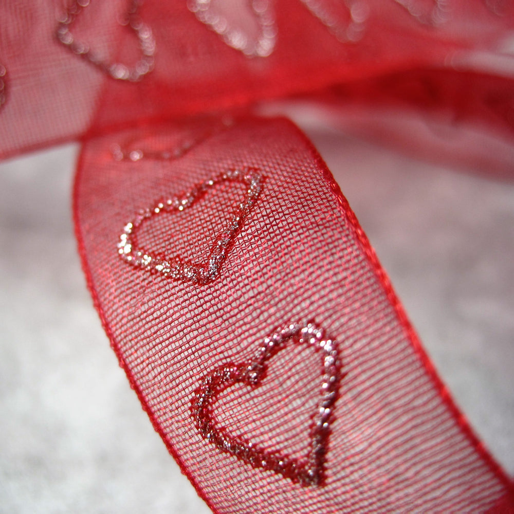 Sheer Red  Ribbon with Heart motif.