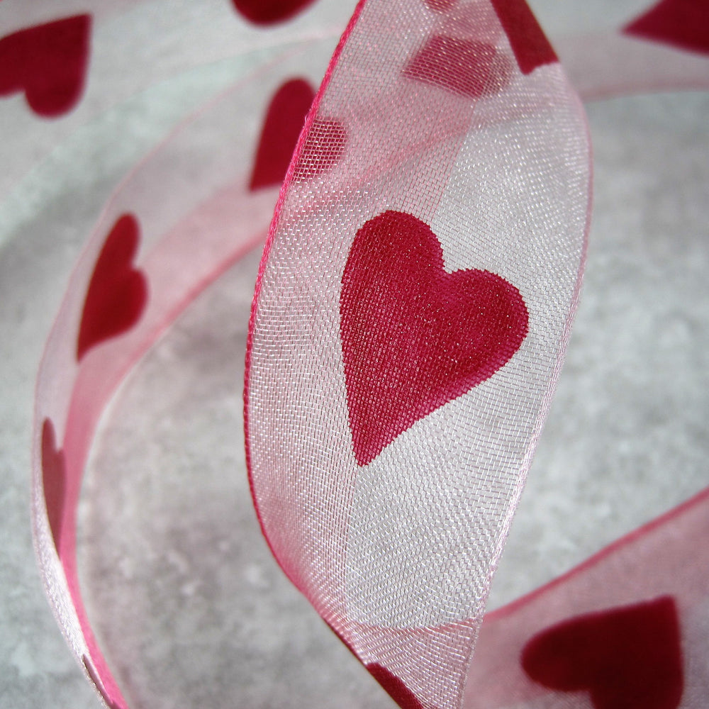 Sheer Pink Ribbon with Red Heart motif.