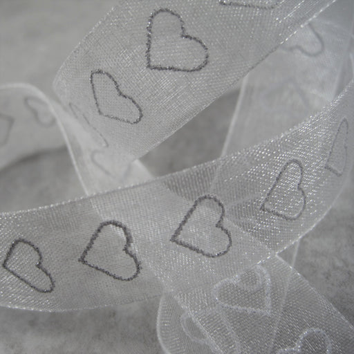 Sheer white  Ribbon with Heart motif.