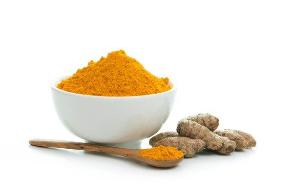 Organic Ground Turmeric and Root in a white bowl