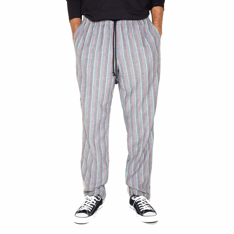 RF20 pant is a slimmer fit and has a higher rise than the original pant. It has an elastic waistband with a drawstring and toggle closure.   All Skidz garments are produced on a limited run. Each plaid fabric is unique and limited in availability and may not be reproduced again.  RF20 fit Faded multi-colored stripes 100% cotton flannel elastic waistband with drawstring and toggle closure side seam pockets and back right pocket made in the USA