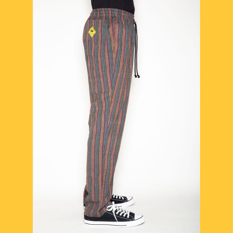 RF20 pant is a slimmer fit and has a higher rise than the original pant. It has an elastic waistband with a drawstring and toggle closure.   All Skidz garments are produced on a limited run. Each plaid fabric is unique and limited in availability and may not be reproduced again.  RF20 fit Multi colored stripes 100% cotton elastic waistband with drawstring and toggle closure side seam pockets and back right pocket made in the USA