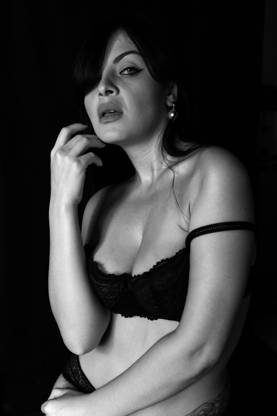 Black and white portrait of a woman in lingerie