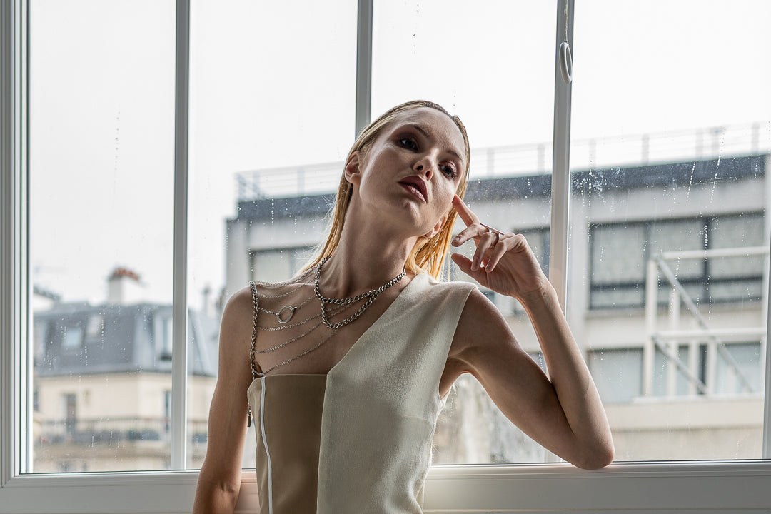 Blonde woman model in haute couture clothes during a studio shoot