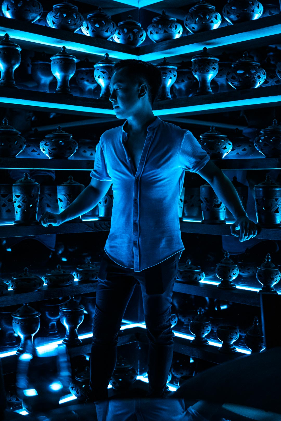 Male Asian model posing with blue neon colors