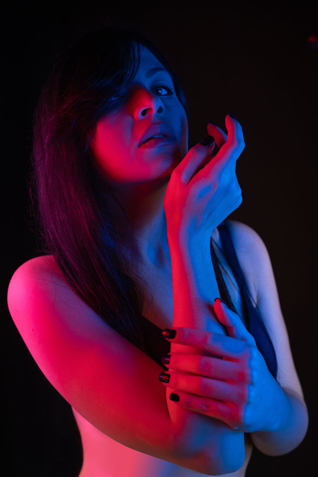 Female model posing with neon colors