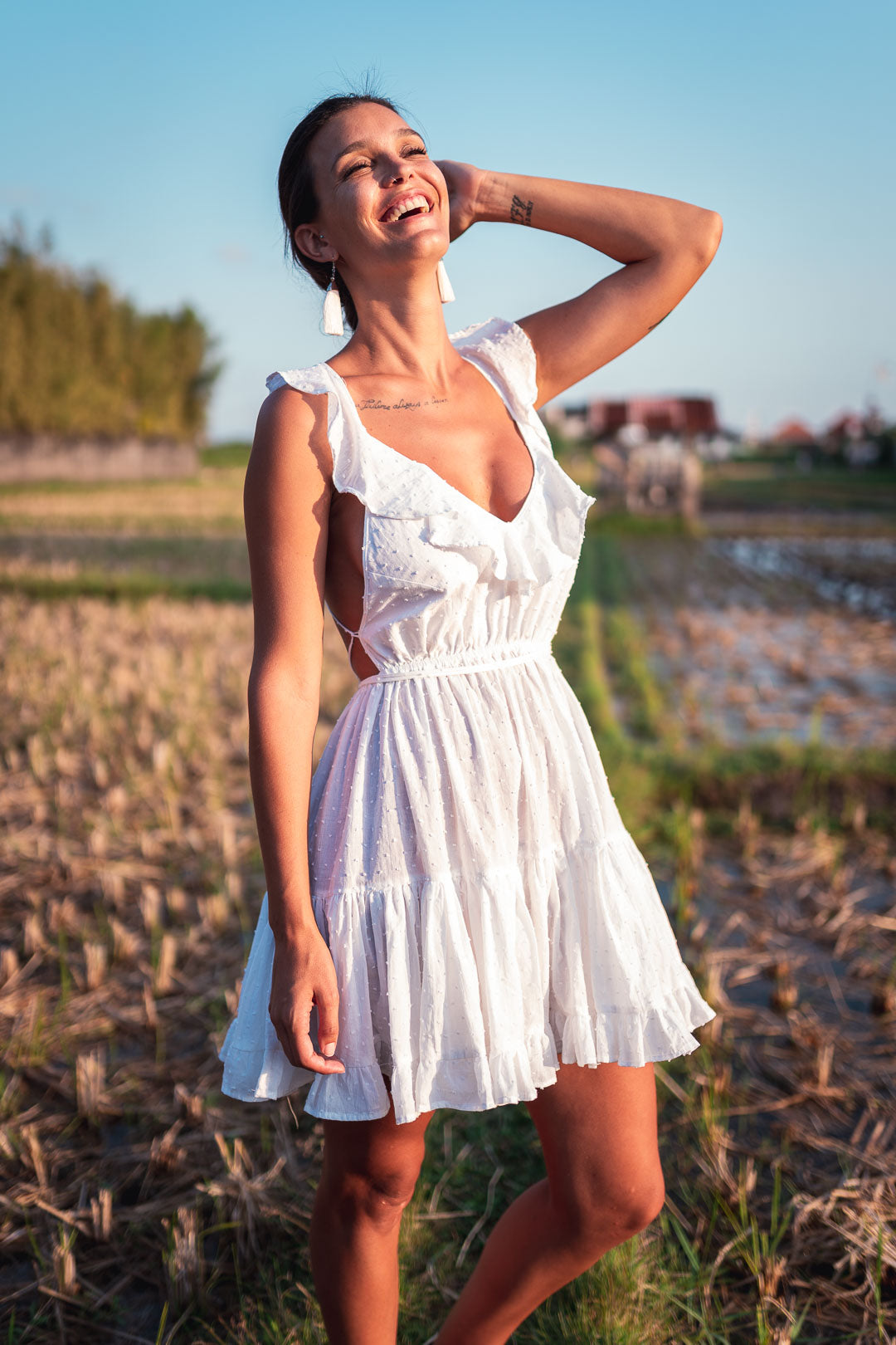 Female model with white dress at a rice field in Bali