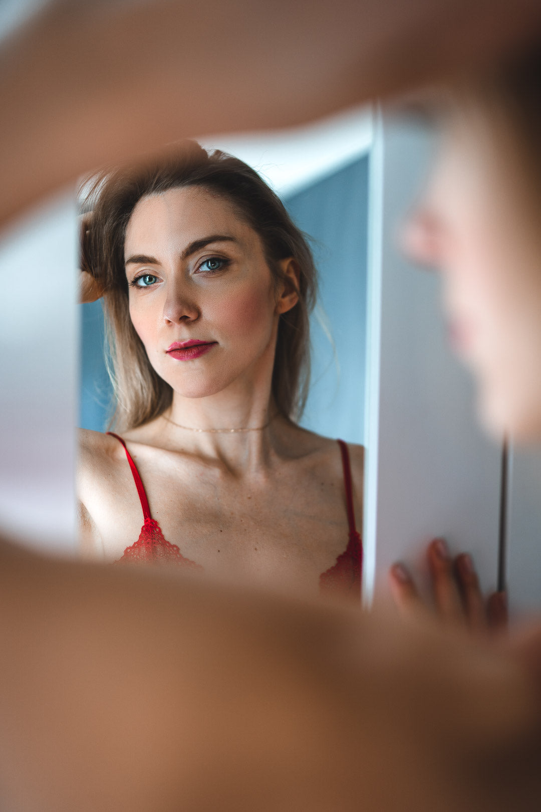 portrait of a woman looking at herself in the mirror