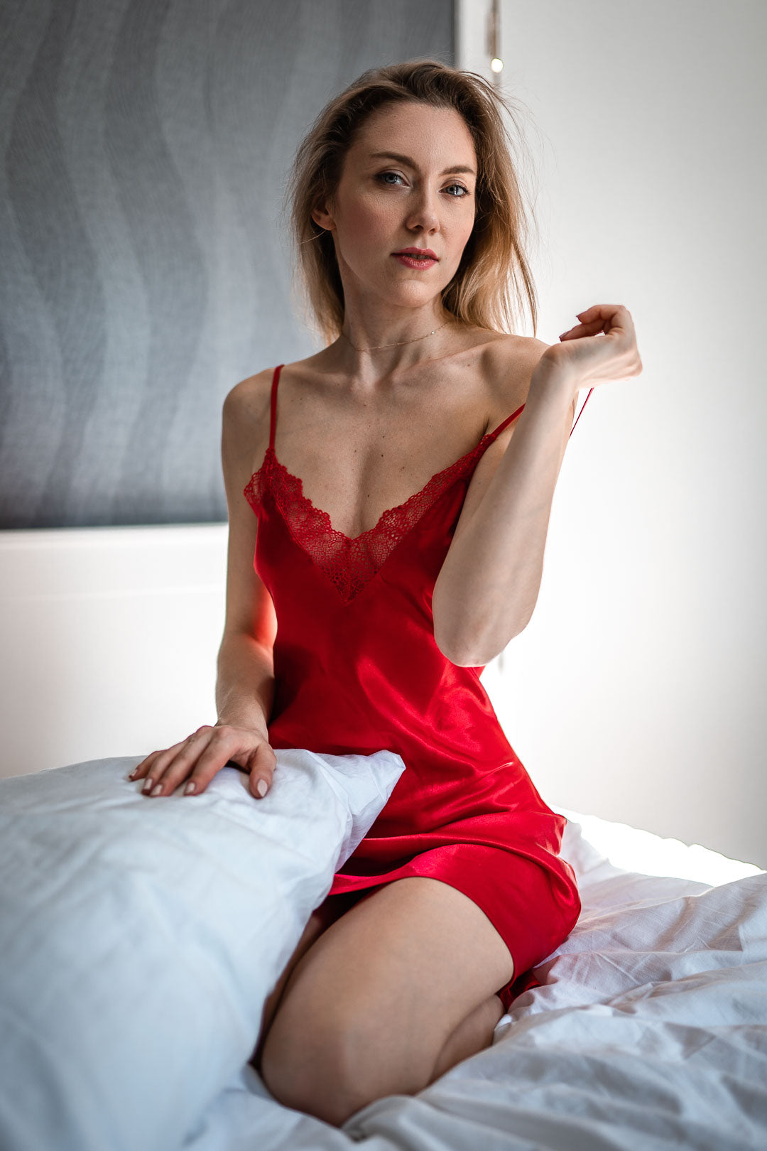 Woman in bed in red nightie