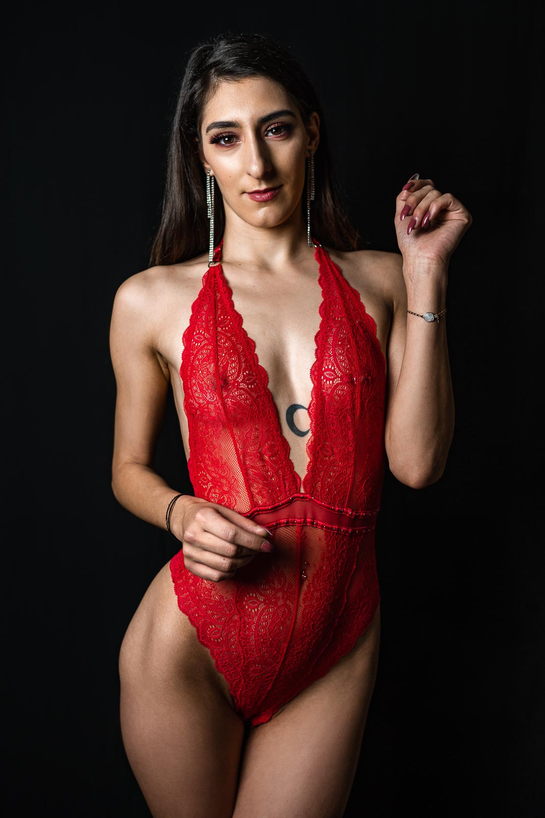 Portrait of a woman in red lingerie in photo studio