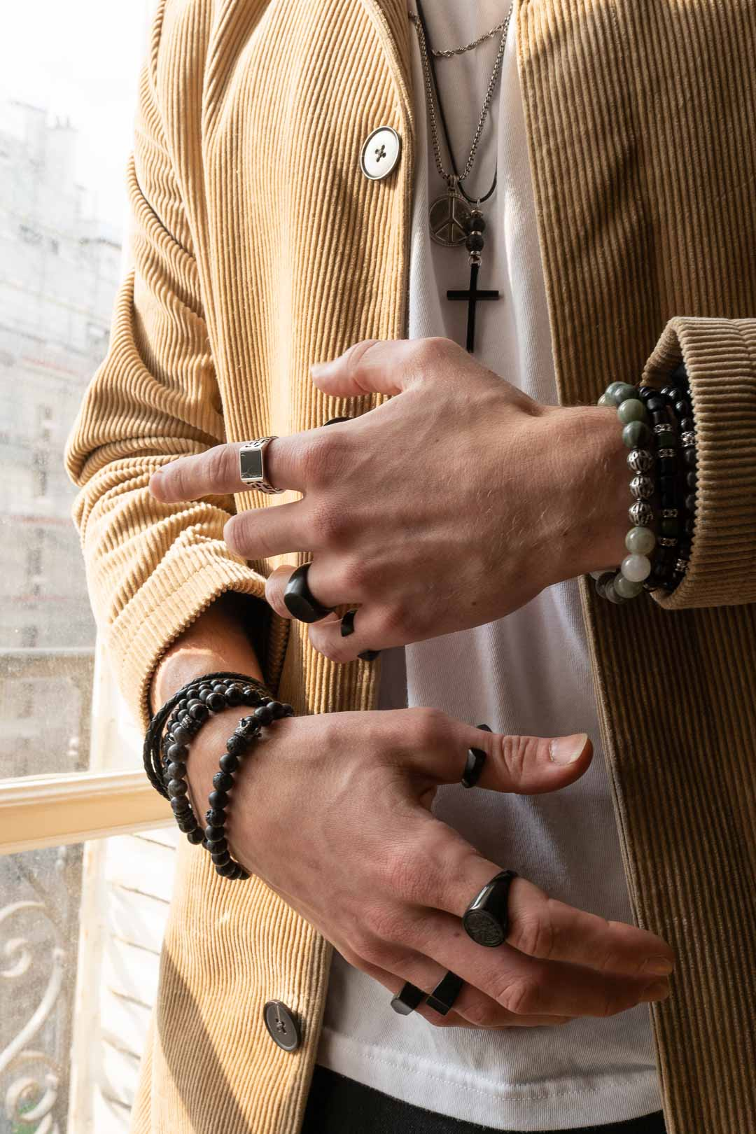Man wearing rings and bracelets