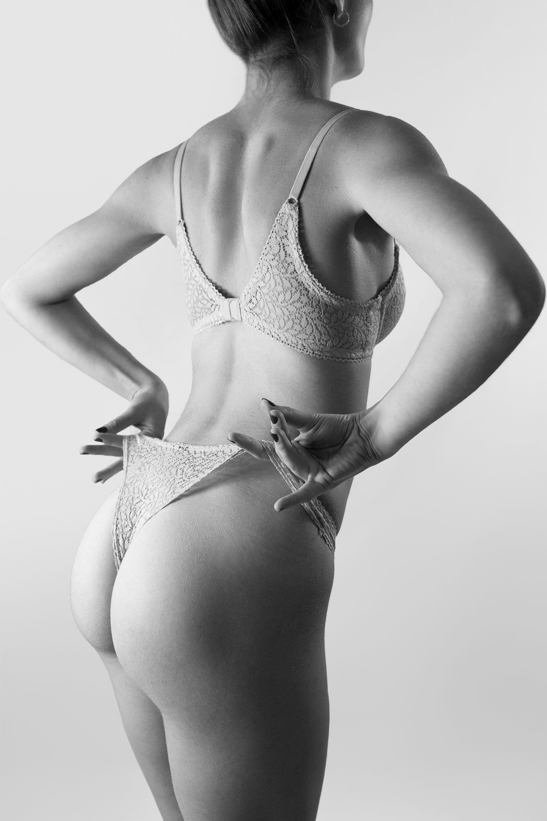 Female model wearing Aubade lingerie set, black and white photography