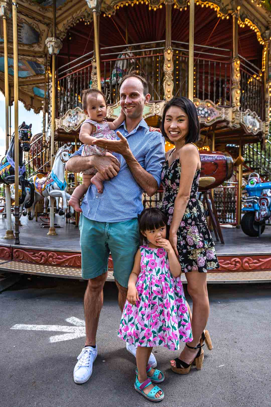 Family portrait in front of the Eiffel Tower carousel