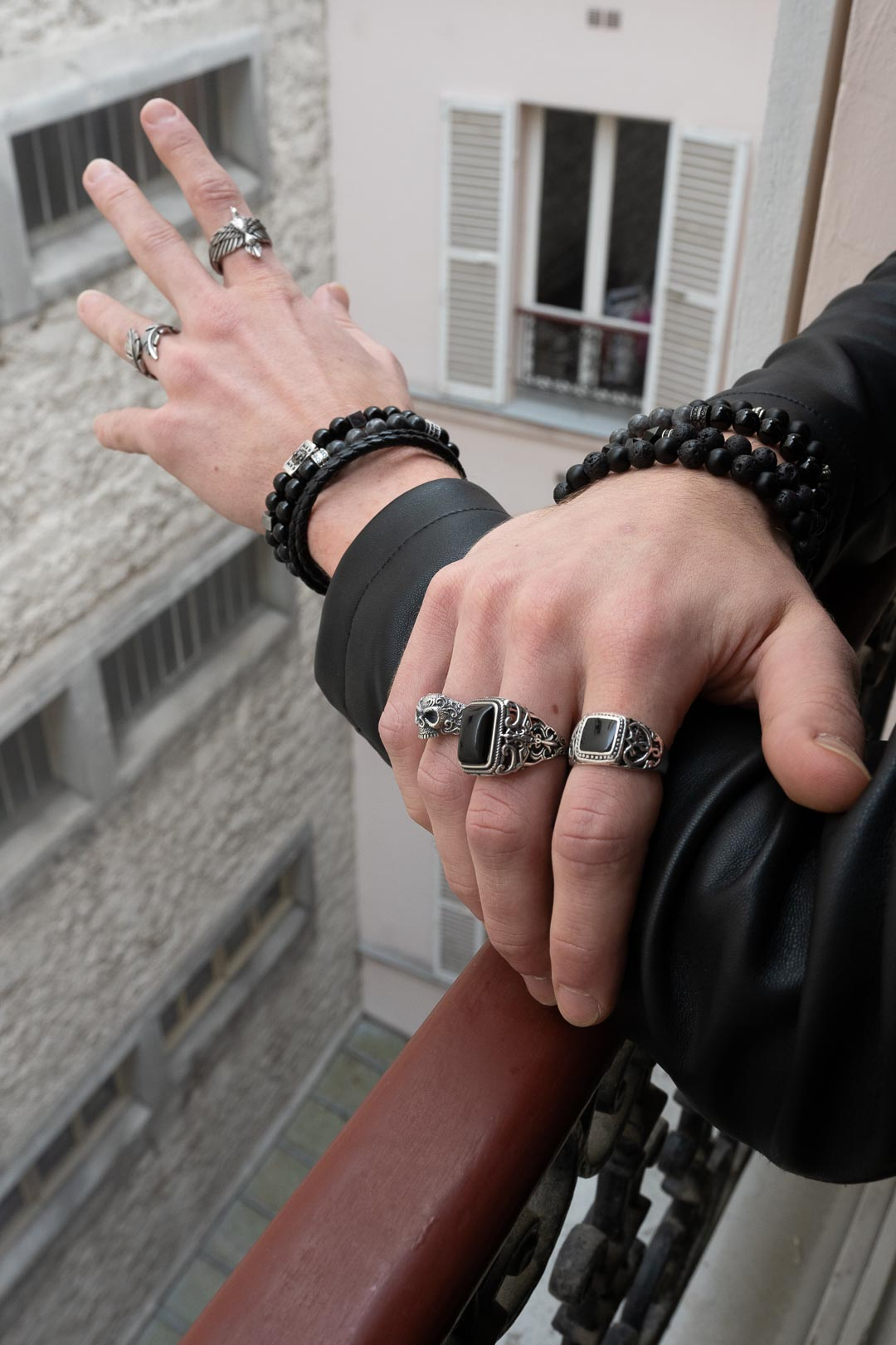 Silver rings and black bracelets