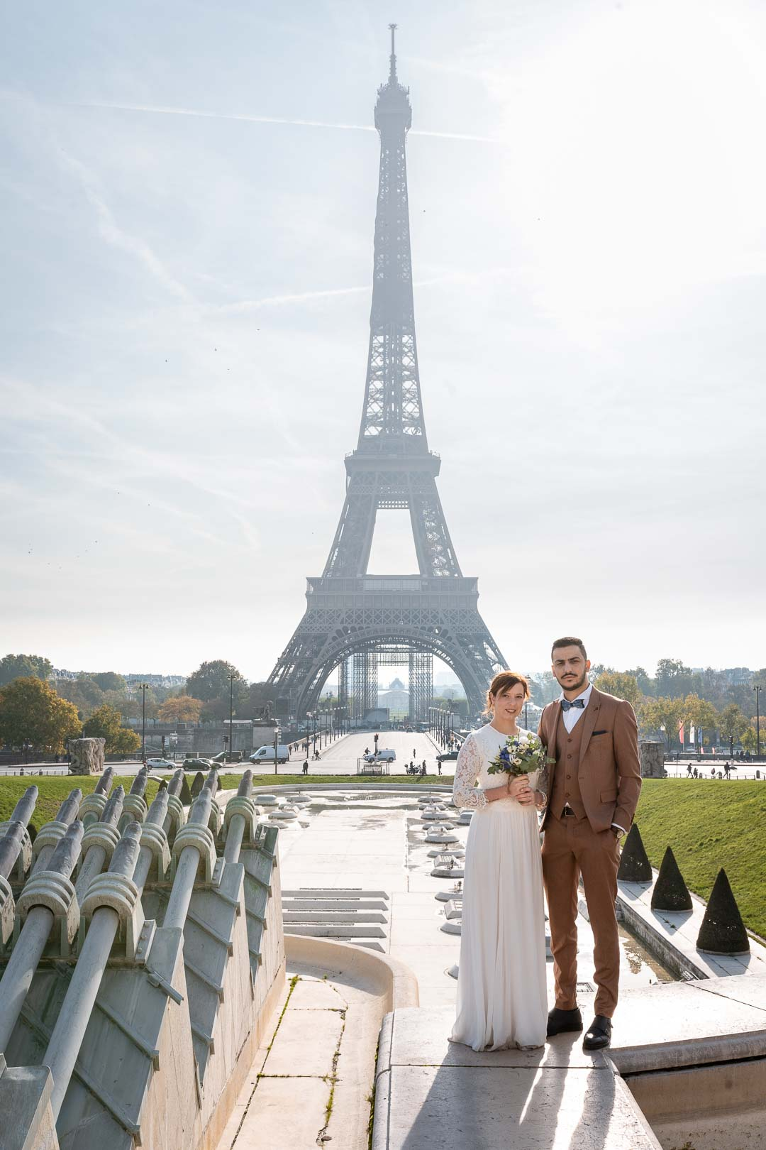 Wedding couple portrait in front of the Eiffel Tower