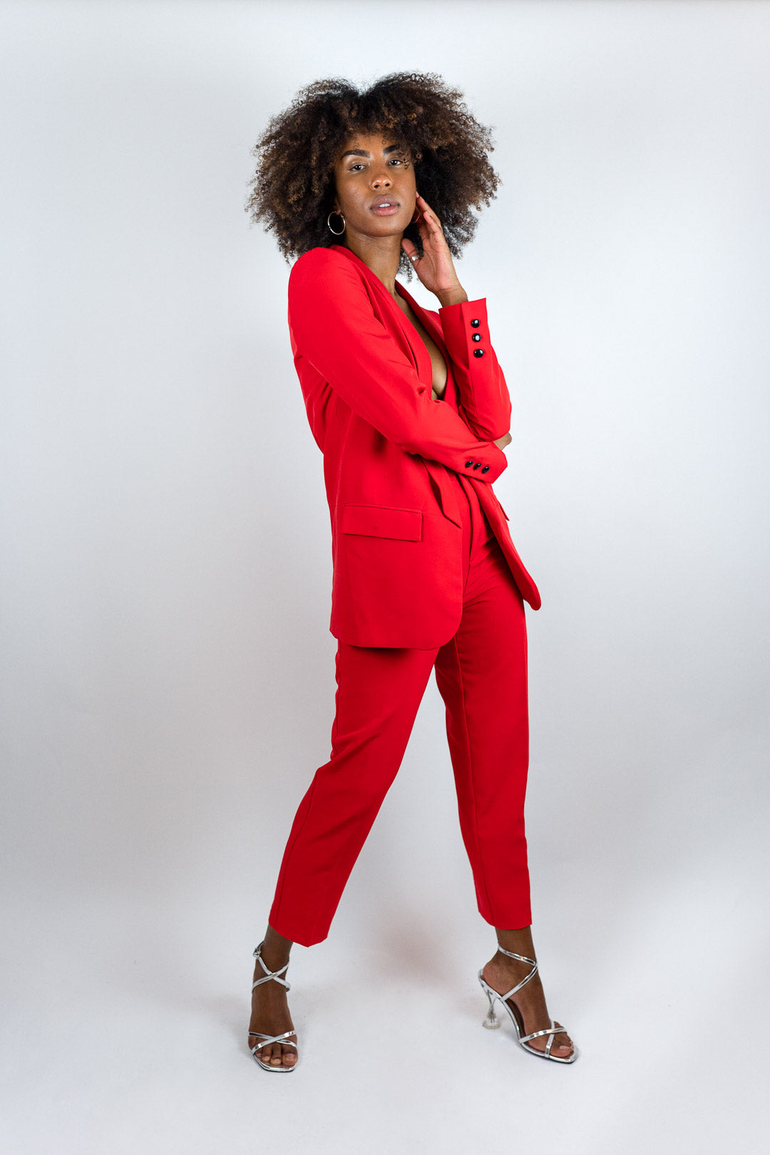 female model in in red costume for fashion shoot