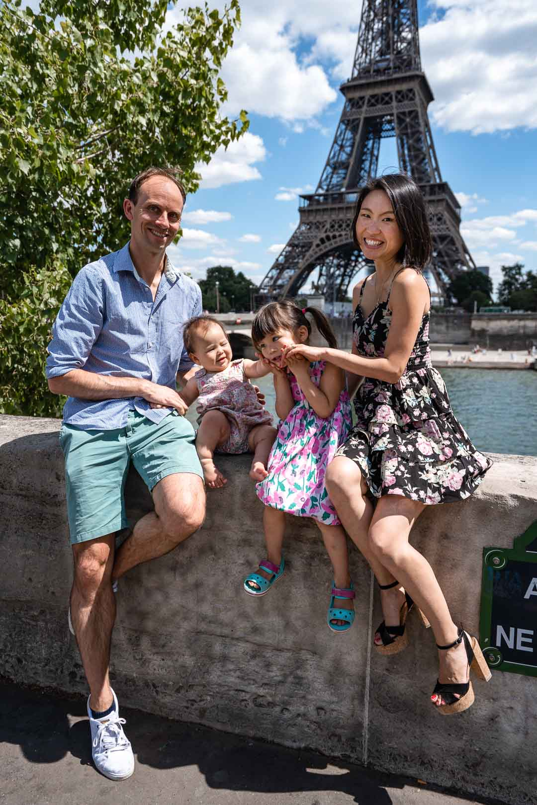 Family portrait in front of the Eiffel Tower