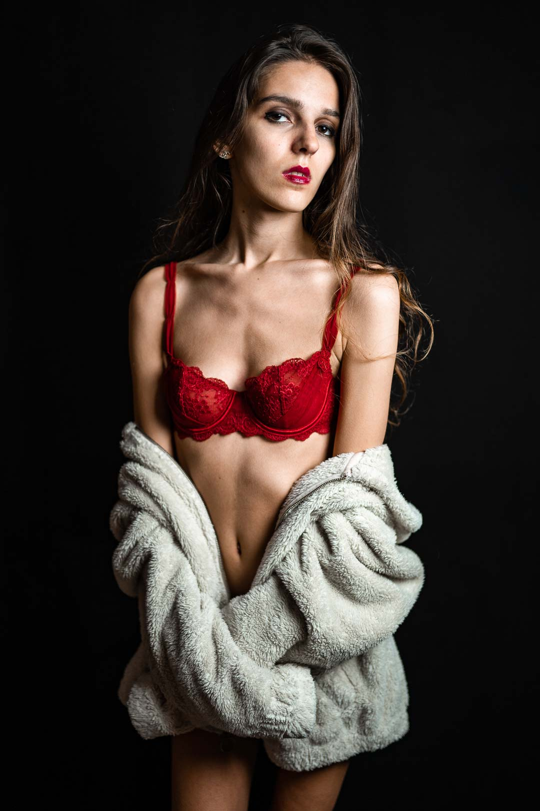 Brown haired woman model in red lingerie