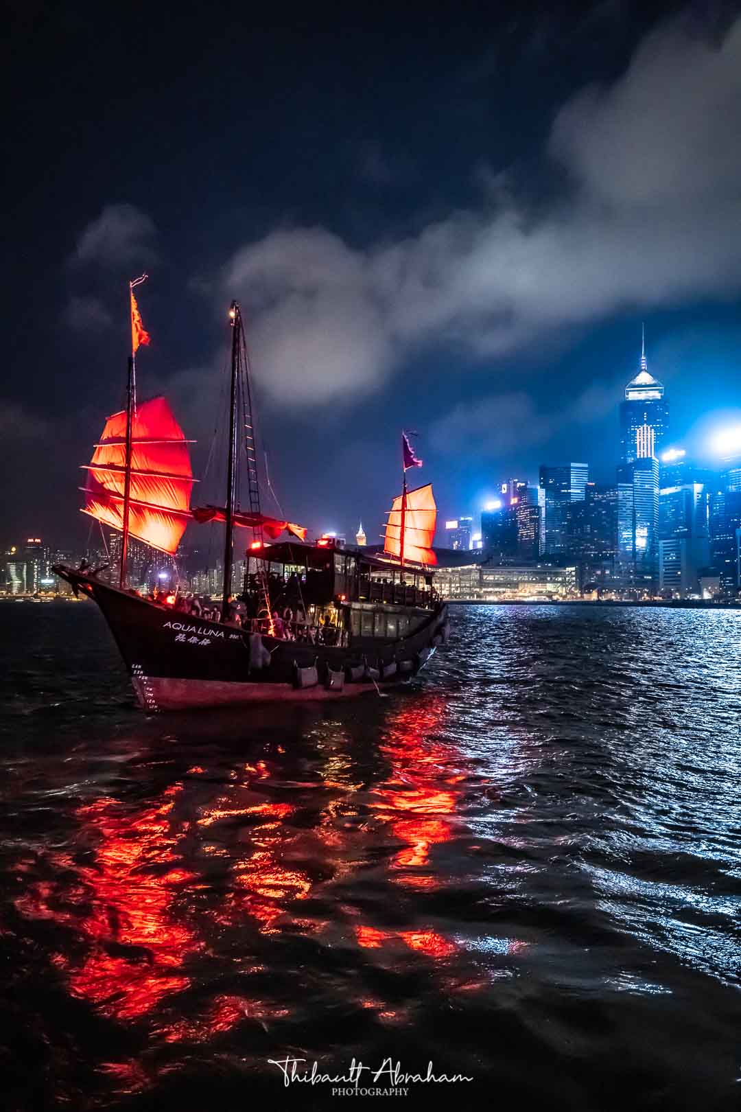 Aqualuna boat at night in Hong Kong