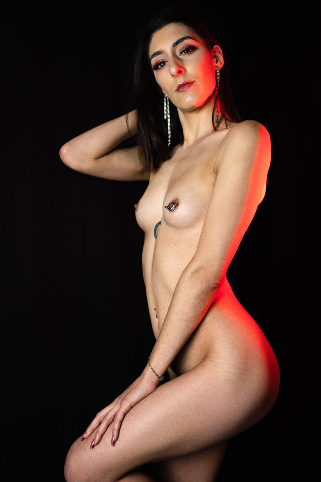 Artistic nude of a woman in photo studio