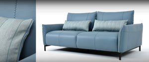 luxurious leather sofa with fabric lumbar pillows