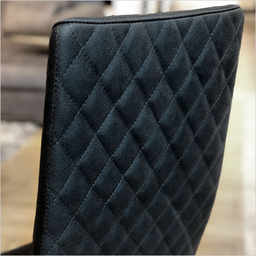 high back dining chair with quilted diamond back panel upholstered in leather