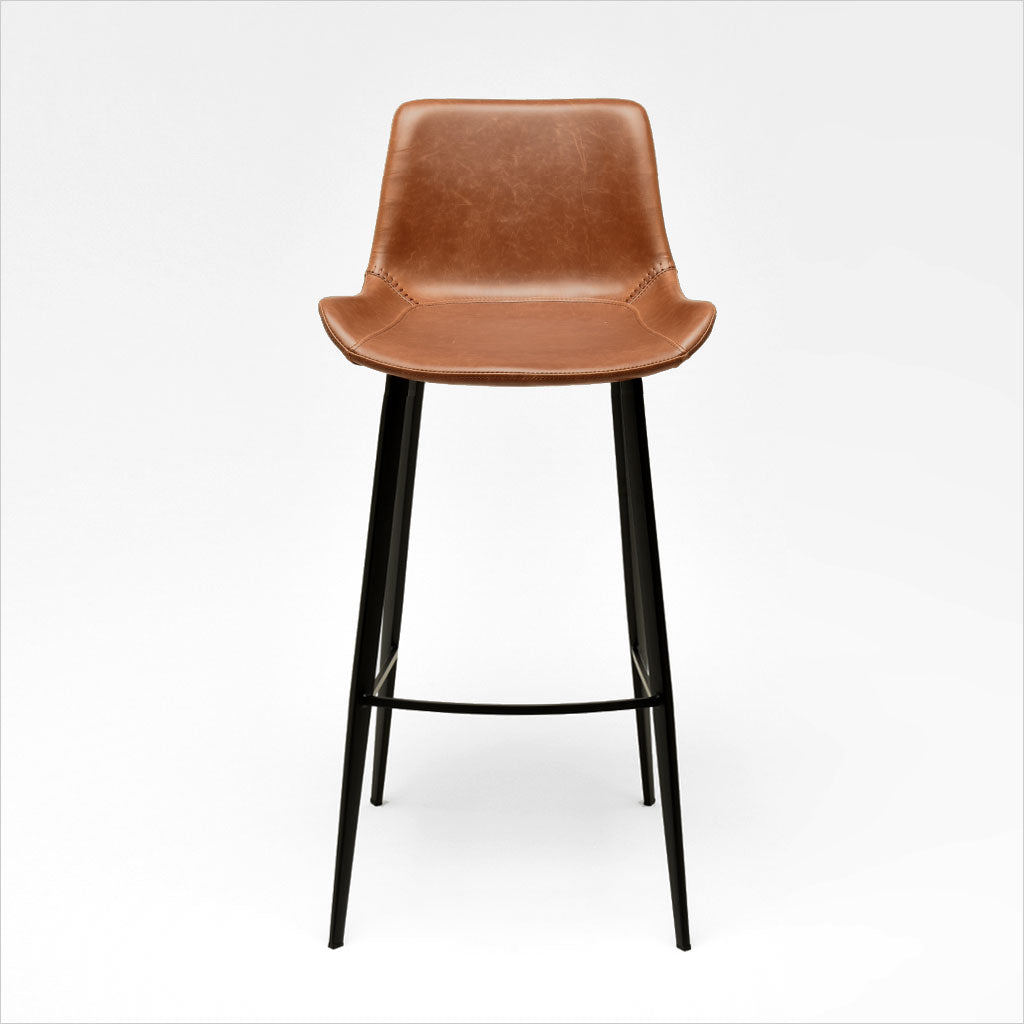 barstool with baseball stitching along edges and curves