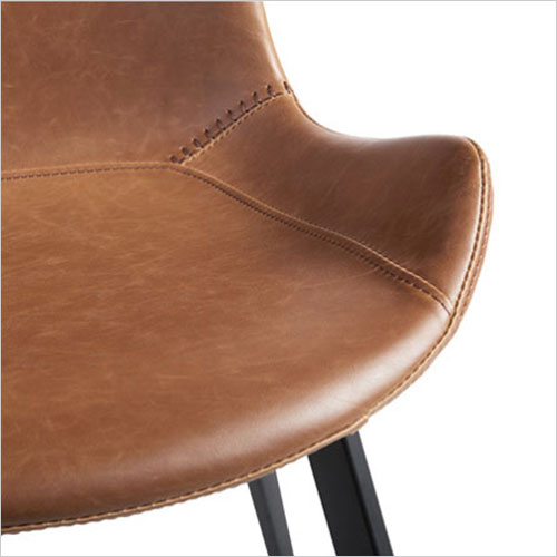 dining chair with baseball stitching along edges and curves
