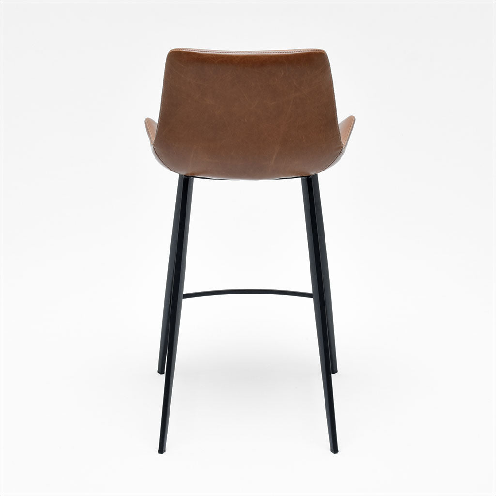 counter stool with baseball stitching along edges and curves