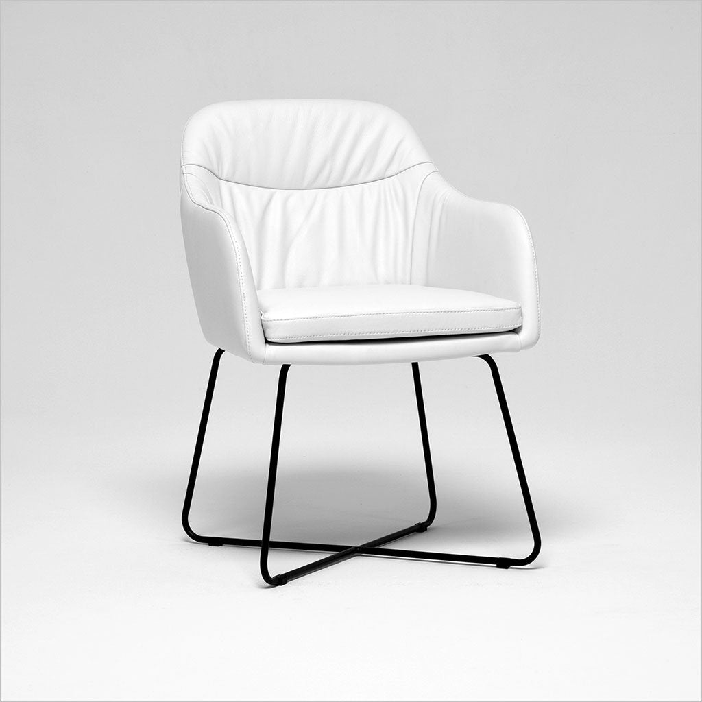 white leather upholstered dining armchair