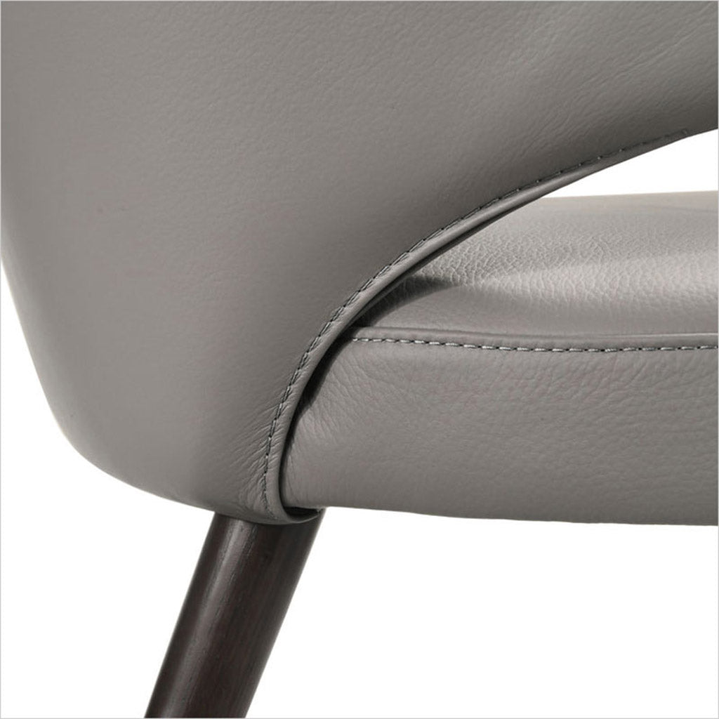 leather upholstered chair with arms and curved back