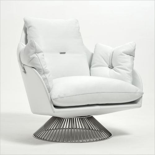 white leather upholstered armchair on pedestal base
