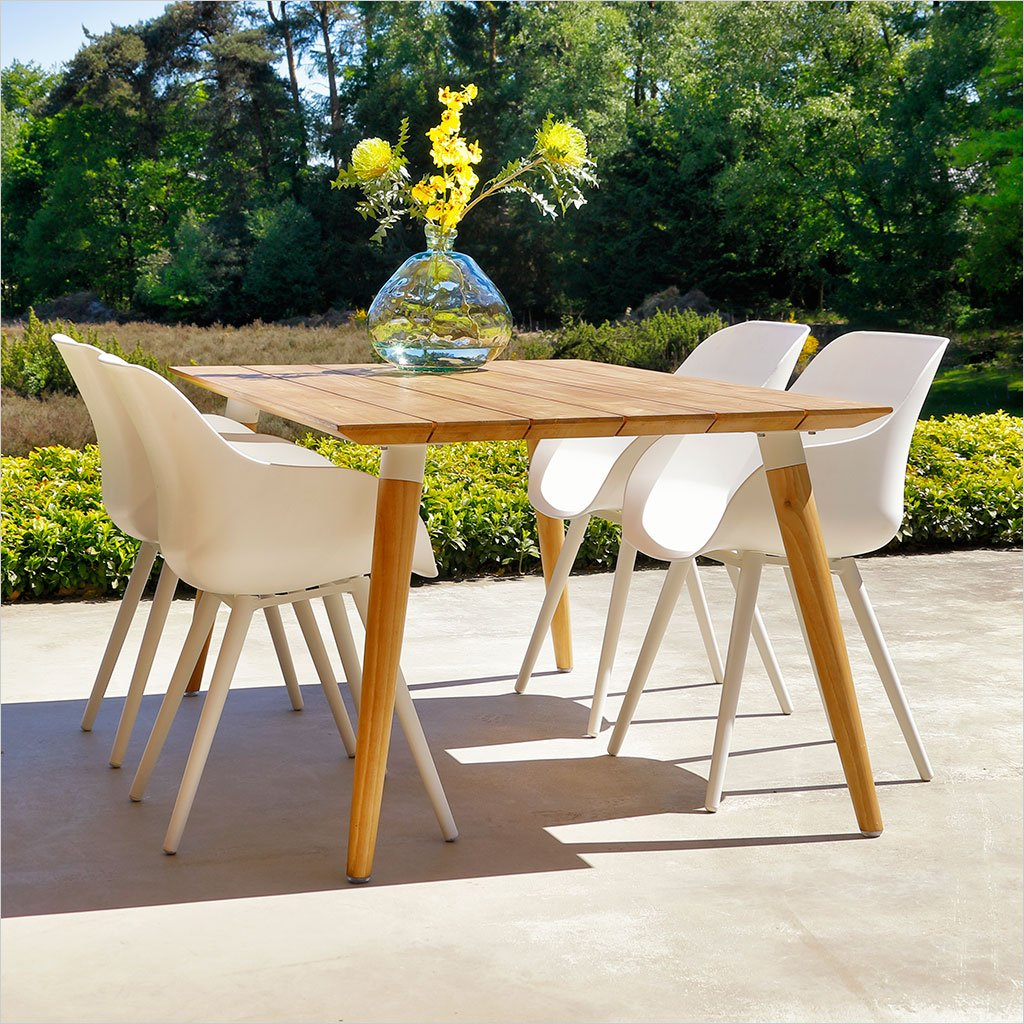 outdoor dining table in teak with white accents