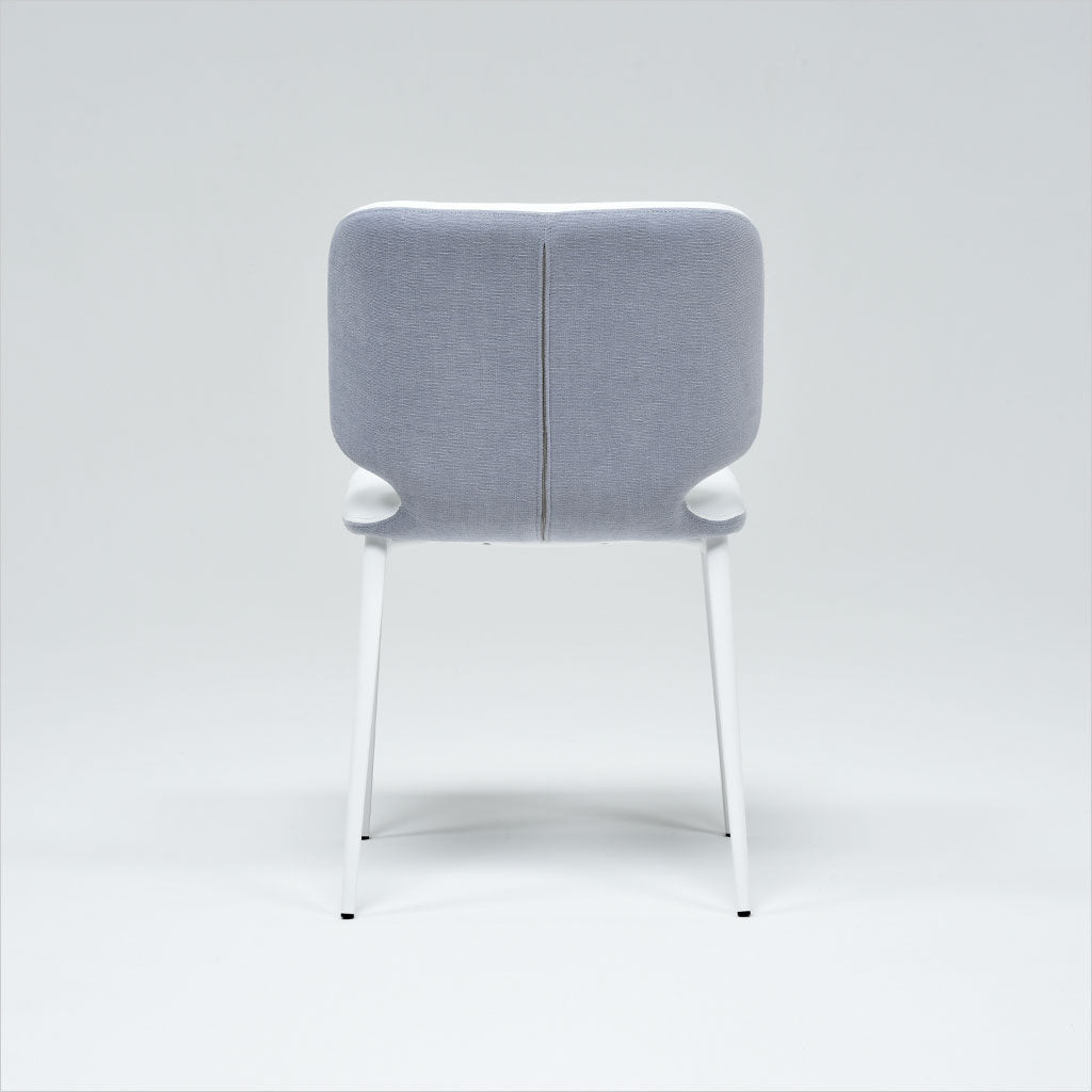 dining chair upholstered in a leather and fabric combination