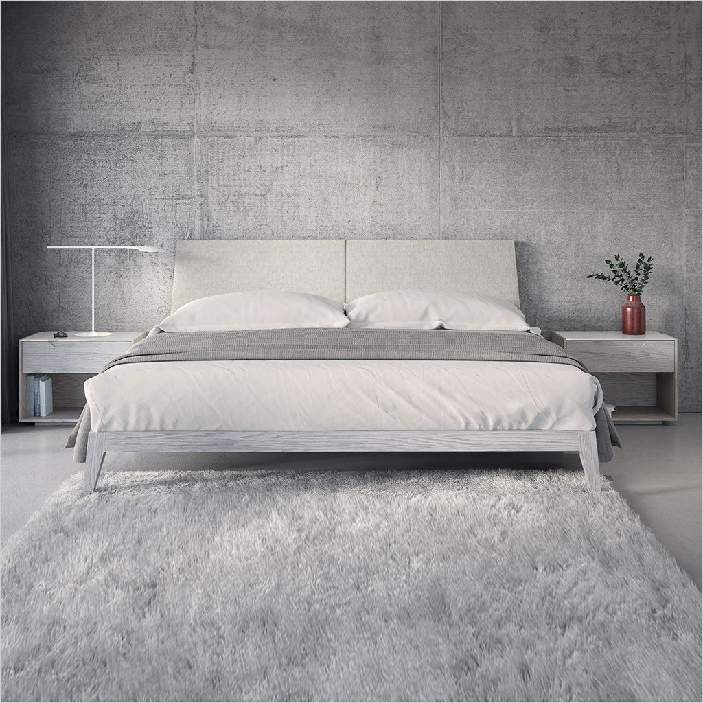 platform bed with upholstered headboard and light grey wood frame