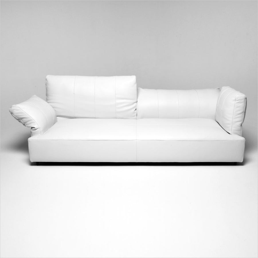 white leather sofa with adjustable arms and backs
