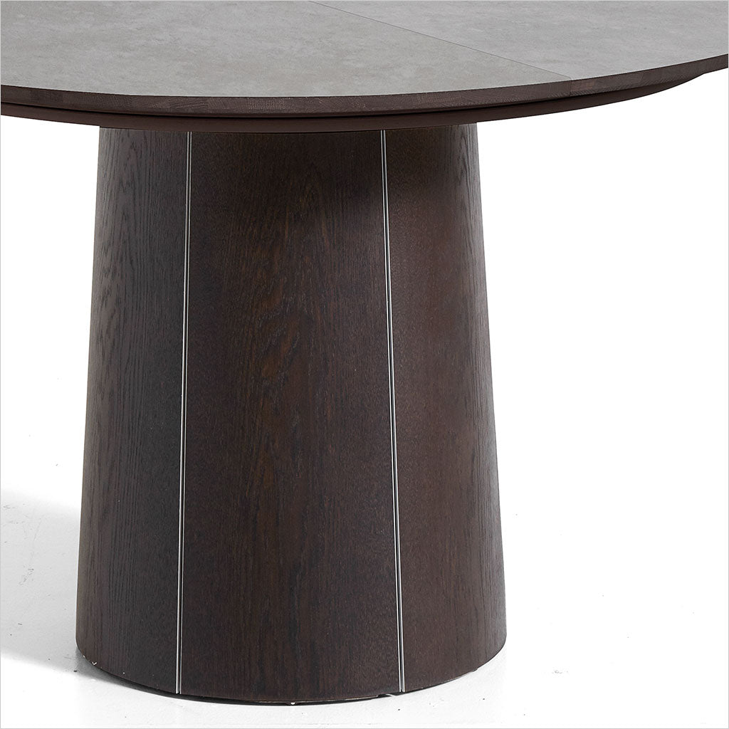 round dining table with extension leaves and pedestal base