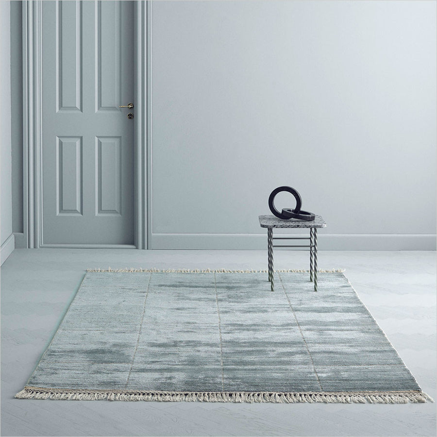 turquoise loom-knotted area rug