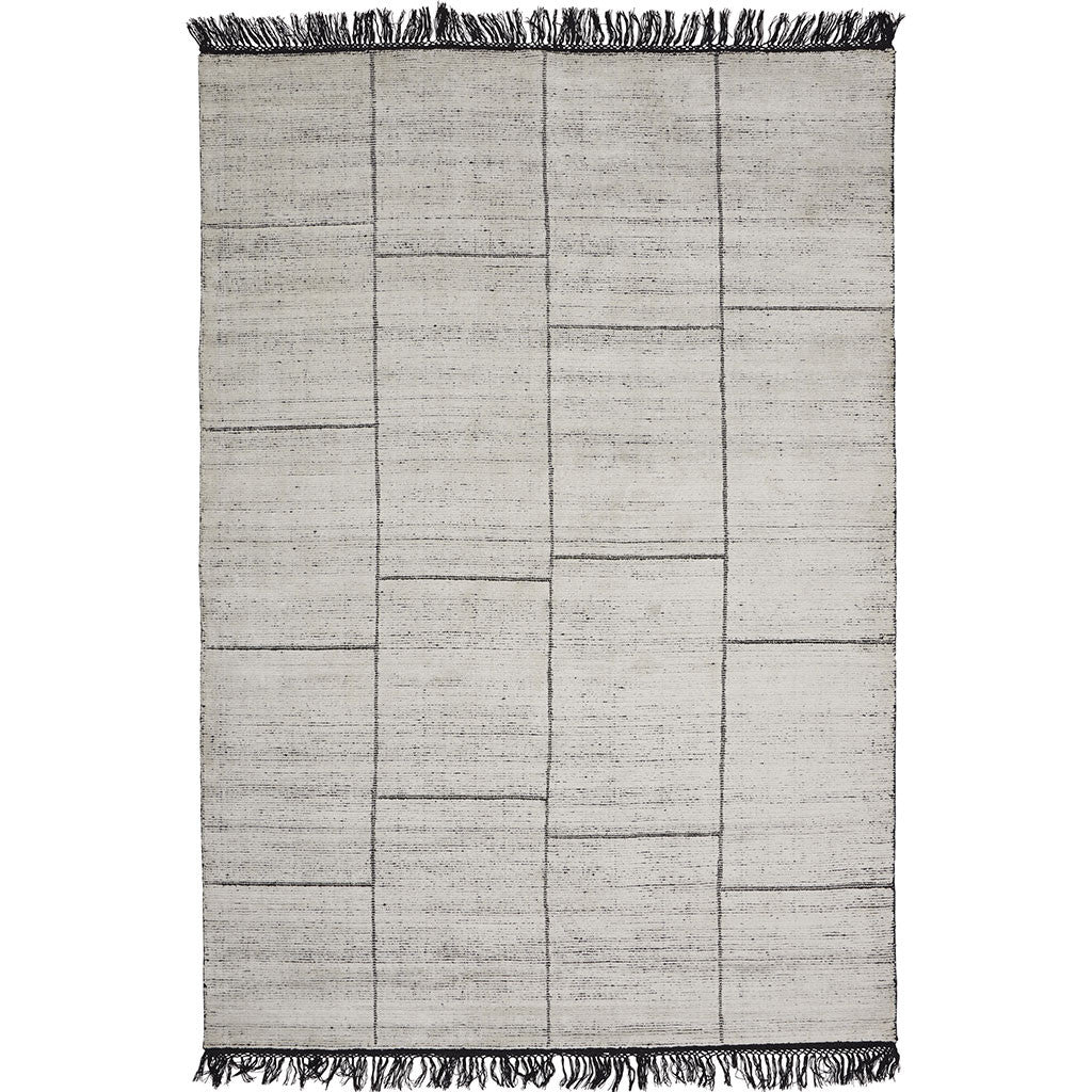 white and black loom-knotted area rug