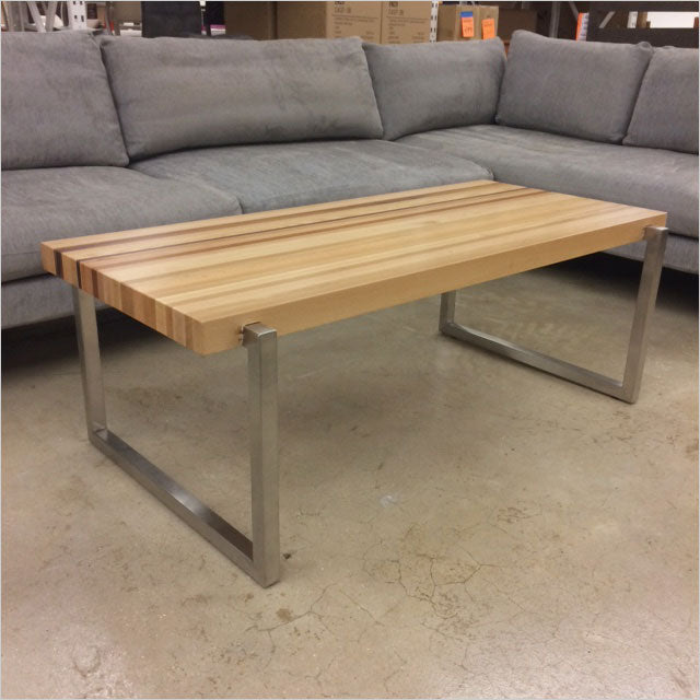 coffee table with solid wood and polished stainless base