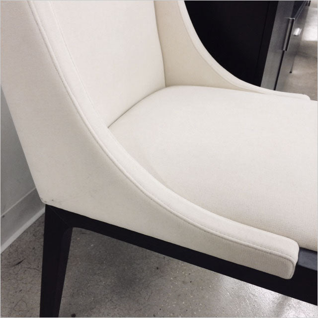 high back dining chair upholstered in white fabric