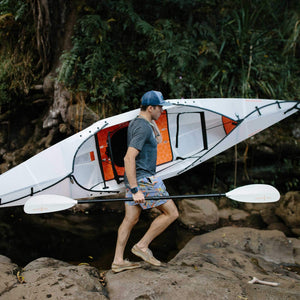 man carrying Oru Kayak Beach LT